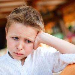 Portrait of very upset little boy